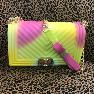 Handbags - New with tags. Rubber bag with gold hardware